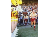 08 - Wally Lewis leads the Broncos onto Lang Park