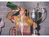 15 - Wally Lewis celebrates the first Broncos trophy - The Panasonic Cup win of 1989