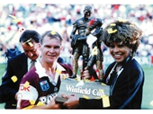 44 - Alfie and Tina Turner hoist the 1993 Winfield Cup