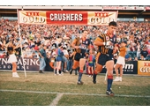 54 - The South Qld Crushers run onto Lang Park