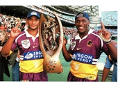 77 - Lote Tiquiri and Wendell Sailor celebrate their 1998 NRL Grand Final win
