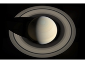 70 - Saturn from above it