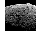 82 - Saturn's moon Iapetus showing its Equatorial ridge