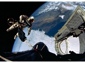 34 - Ed White Floats out the Open Hatch for first American spacewalk