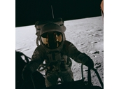 82 - Apollo 12's Pete Conrad stepping down onto the Moon