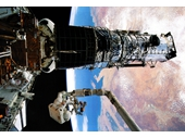 162 - Shuttle crew working on Hubble telescope over Adelaide