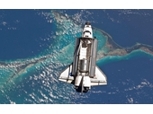 166 - Space Shuttle flying above Earth