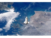 168 - Space Shuttle Endeavour flying above Earth