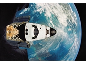 169 - Space Shuttle Atlantis flying above Earth