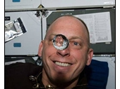 174 - Shuttle astronaut plays with water bubbles in zero gravity