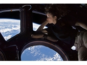 191 - Tracy Dyson looks out the windown on  the International Space Station
