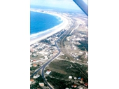 1970's Aerial view of Tugun (Path of old rail line visible which would become other part of highway)