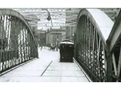 10 - An early electric trams crosses Victoria Bridge