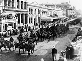 75 - Soldier march down Queen St during World War I