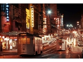 9 - Queen St at night with a couple of trams