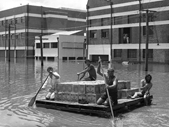 76 - A group of men ensure that the beer gets through during the 1974 Flood