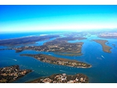 93 - Southern Moreton Bay - Lamb Island (bottom left), Macleay (bottom), Karragarra (long one in centre), Russell (centre), Long (right) and North Stradbroke (top left)