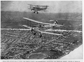 29 - Two bi-planes fly over West End around 1930 with Davies Park and the gasworks visible along the river with St Lucia in the background