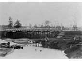 79 - A wooden bridge over Kedron Brook, possibly Gympie Road in 1908