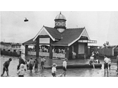 35 - An early photo of children playing in the water next to the Oxford Street ferry terminal