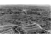 47 - An aerial view looking towards the City from above Camp Hill showing the new estate being opened up in the 1920's after the tram line was extended in 1925
