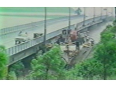 104 - A ship jams up against the Centenary Bridge in the 1974 flood which had to be blasted and sank