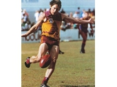 58 - A Brisbane Bears player kicks in their original jersey