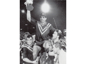 61 - Mal Meninga holds up the Ashes after winning the 1992 series against Great Britain