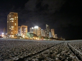 09 - Towers of Surfers from Beach at Night